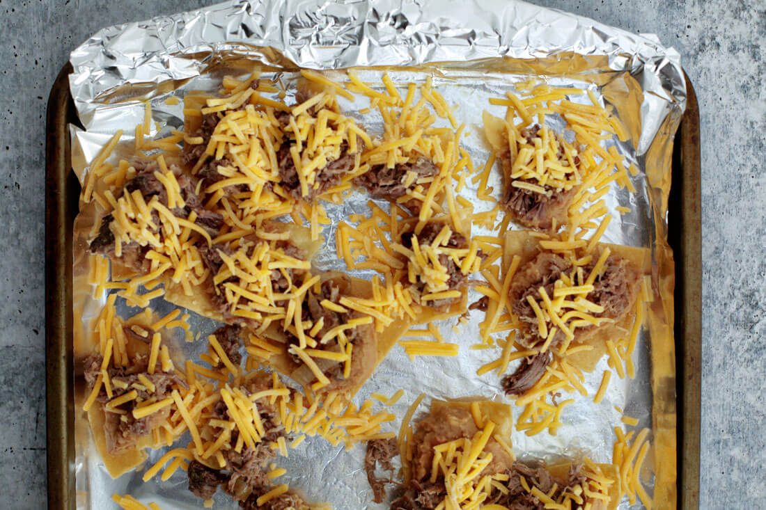 The key to making awesome nachos is to separate the chips and individually add ingredients to each chip